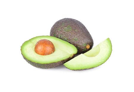 whole and cut avocado with seed on white background Imagens