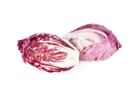 whole and half cut fresh radicchio on white background Imagens