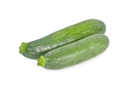 whole unpeeled fresh zucchini on white background