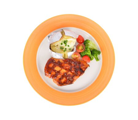 top view grilled chicken steak with potato tomato broccoli on plate with white background