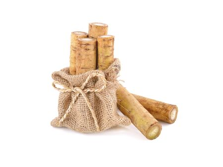fresh burdock root or Gobo in sack and on white background