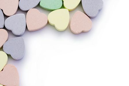 sweethearts: Colorful candy sweet hearts around edges of white