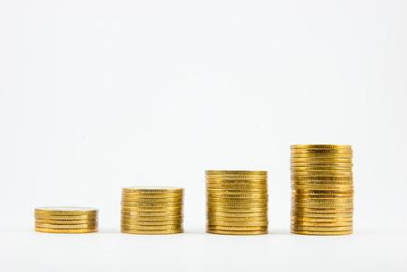 Gouden munten geïsoleerd op witte achtergrond Stockfoto