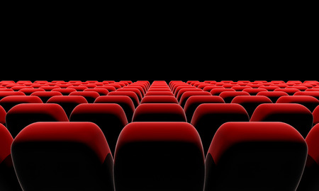 Cinema or theater seats in front of black screen with clipping path.