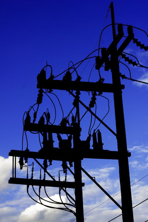 electricity post: silhouette electricity post with wired and blue sky background Stock Photo