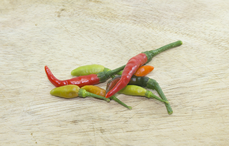 chopping board: Chopping board with Chili Peppers. Stock Photo