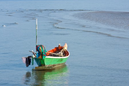 Boat of fisherman stay on ground photo