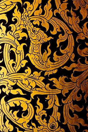 Thai style painting on door of temple,Wat Phrananchoeng, Ayutthaya Thailand photo