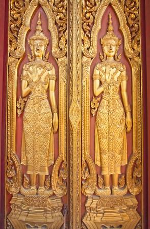 The Wood Carving Door of Thai Temple, Wat Yai Chaimongkol, Ayutthaya Thailand  photo