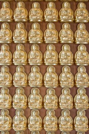 far eastern: Ten thousand buddha on Chinese temple wall, near bangkok Thailand