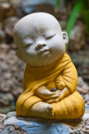 buddha face: Sculpture of novice in the buddhist religion image