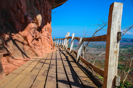 Wooden walkway on the steep cliffs, sky blue background