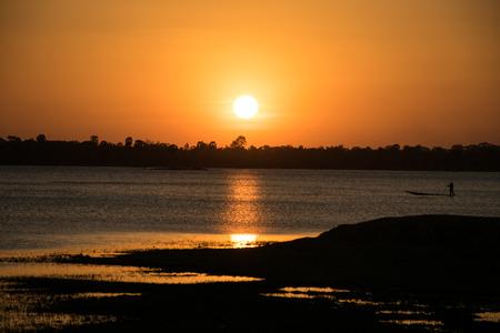 avocation: Sunshine in the evening,have fisherman boating inside river, sunset background