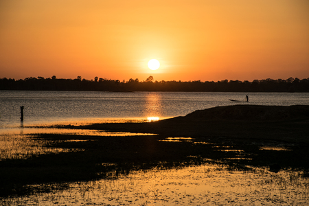 Sunshine in the evening,have fisherman boating inside river, sunset background, beautiful lanscape Stock Photo