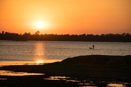 Sunshine in the evening,have fisherman boating inside river, sunset background, lanscape background Stock Photo