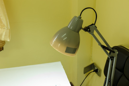 Lamp is lighting on the table in the room in this house, concept table background