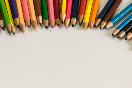 crayon and pencil arrangement  above of olden image and concept  zooming image and white  background, Stock Photo