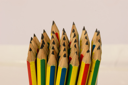Bundle pencils  point to top of image, white background Stock Photo