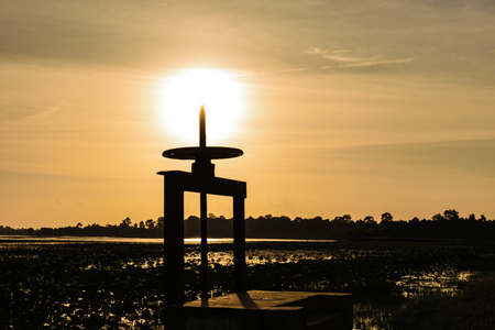 floodgate or Drainage point to the sun in the evening inside of lotus in the river , sunshine background,concept shadow image