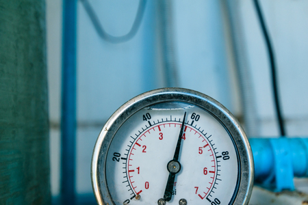 Pressure gauge show number of pressure of water lining pass tube, blurring background of image Stock Photo