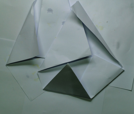 Folding paper background,The folded shape of paper overlaps several sheets