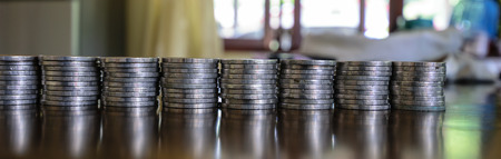 tax aligned: silver coins aligned on the table