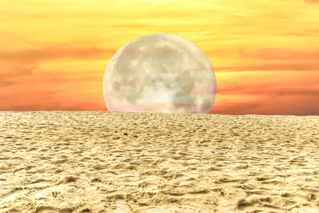 sand beach with moon twilight gold sky background texture ,close up white moon Stock Photo
