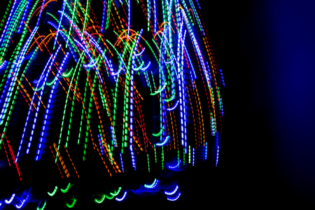 The beautiful lighting of path when there is movement of the origin of multi colored lights. Slow shooting style and light color blur Applied as a backdrop