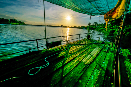boat on river with sunset background, nature wallpaper background concept.
