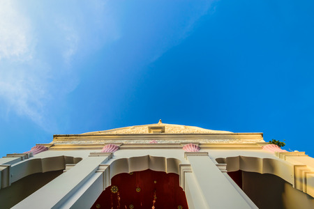 top of Thailand Temple with blue sky. wallpaper religion concept.