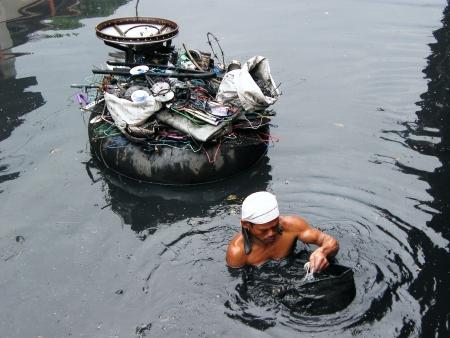 high priced: binman in  waterway Editorial