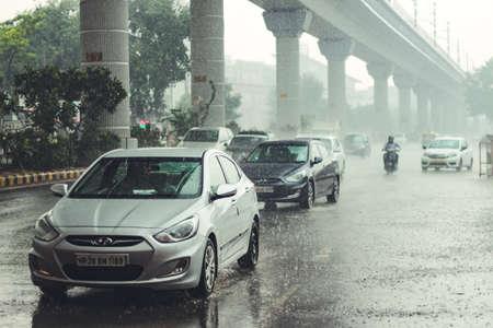 New Delhi, Delhi/ India- May 19 2020: Vehicles on road when ir rained in Delhi, Monsoon arrives in Delhi.