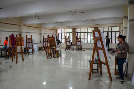 New Delhi, Delhi India- May 31 2020: Classroom of an art school, students maintains social distancing in the class. Artists busy in painting. 에디토리얼
