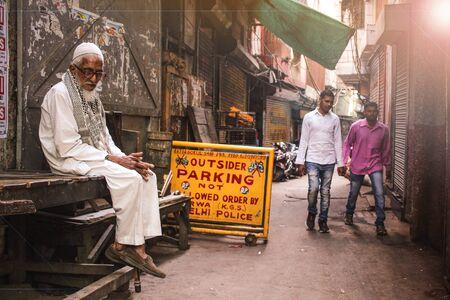 New Delhi, Delhi, India- May 22 2020: Photo of poor old men sitting on a rickshaw Foto de archivo