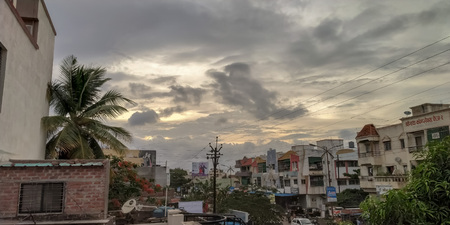 A picture of Indian home infrastructure with dark clouds Redakční