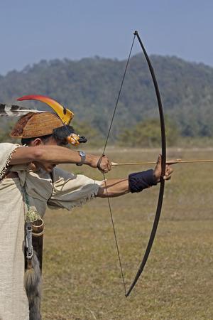 Nyishi tribe, man perform Traditional Bow   Arrow Competition at Namdapha Eco Cultural Festival, Miao, Arunachal Pradesh, India