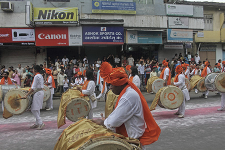 headgear: Indian girls   men wearing headgear called feta and white kurta pajamas and playing musical instrument called
