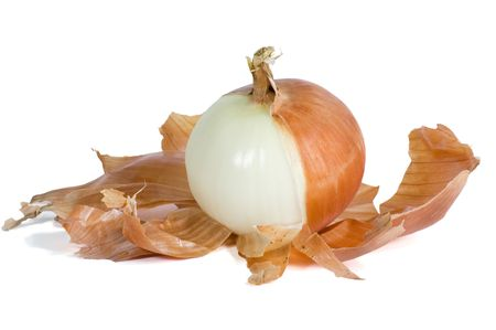 Sweet onion with brown skin half peeled and isolated on white with path.