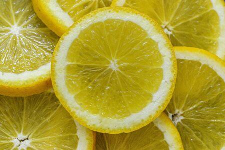 Yellow orange slices on a dark background Imagens