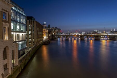 The Millenium Bridge and St Pauls Cathedral Illuminated in the Blue Hour 写真素材