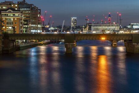 The Millenium Bridge and St Paul's Cathedral Illuminated in the Blue Hour