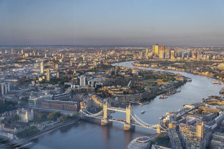 Aerial drone bird's eye view of iconic Tower Bridge, the skyline in City of London, United Kingdom