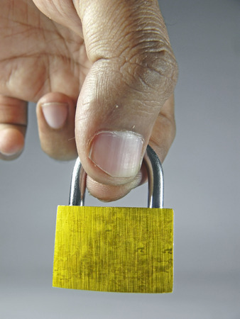 A small Padlock in Human Hand photo