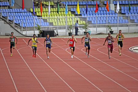Male athletes running on track