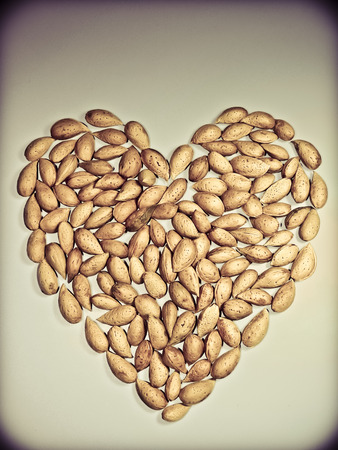 Almond nuts in arranged heart shape photo