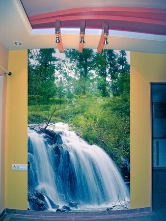 Poster of Waterfall on a wall photo