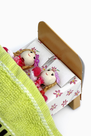 doll lying on bed photo