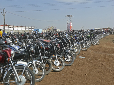 Motorcycles, bikes are parked at an office place