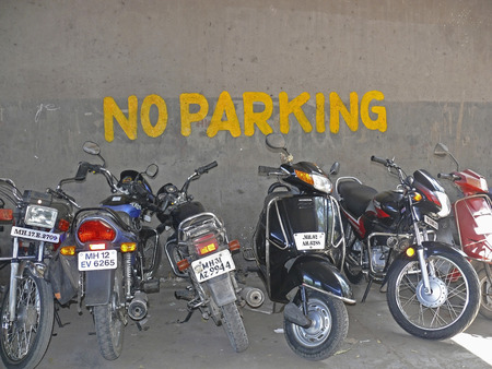 Motorcycles, bikes are parked at the place of No parking