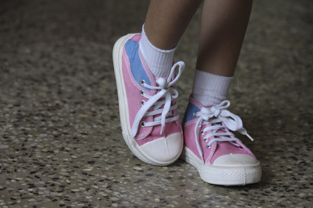Girl with canvas shoes photo
